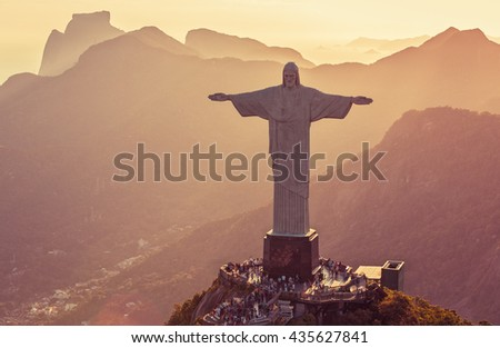 RIO DE JANEIRO, BRAZIL - CIRCA FEBRUARY 2016: Aerial view of Christ The Redeemer Statue and people visiting Corcovado Hill. Warm afternoon light. - stock photo