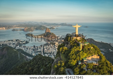 RIO DE JANEIRO, BRAZIL - CIRCA FEBRUARY 2016: Aerial view of Christ The Reedemer Statue and Sugar Loaf Mountain from high angle. - stock photo