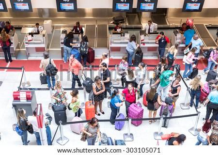 RIO DE JANEIRO, BRAZIL - CIRCA NOV 2014: Passagers at Santos Dumont Airport in Rio de Janeiro, Brazil. - stock photo