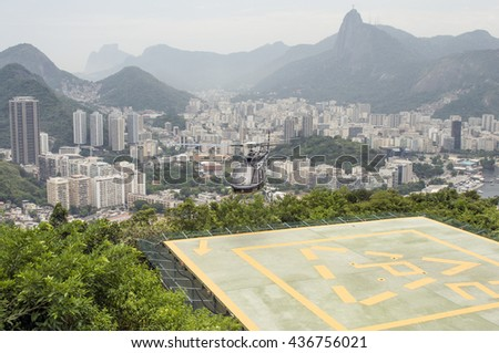 RIO DE JANEIRO, BRAZIL - DECEMBER 21: Helicopter taking off from heliport to offer visitors an aerial view of the city on December 21, 2012 in Rio de Janeiro, Brazil. - stock photo