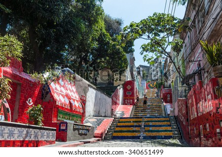 RIO DE JANEIRO, BRAZIL - DECEMBER 21, 2012: Tourists visiting the Selaron stairway in Rio de Janeiro, Brazil. The stairway is famous work of Chilean artist Jorge Selaron. - stock photo