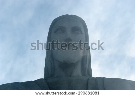 RIO DE JANEIRO, BRAZIL - Feb 02, 2009 Christ the Redeemer  Art Deco statue and famous Brazil Christianity symbol on Corcovado under a shroud of fog on a cloudy day. - stock photo