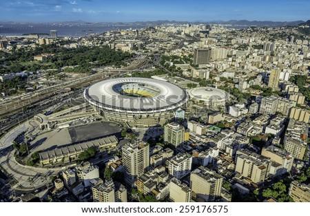 RIO DE JANEIRO, BRAZIL - FEBRUARY 11, 2015: Aerial photo of Maracana Stadium with panorama of Rio De Janeiro. Opening and closing of 2016 Olympic Games will be  held at Maracana Stadium. - stock photo