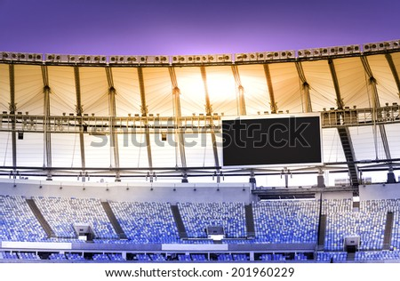 RIO DE JANEIRO, BRAZIL - FEBRUARY 10, 2014: Panorama view of Maracana football soccer stadium from the grandstand during sunset, after two years of extensive renovation and reconstruction. - stock photo