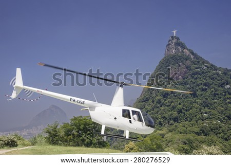 Rio de Janeiro, Brazil, February 13, 2015  Tourist taking a helicopter tour of the Christ the Redeemer statue - stock photo