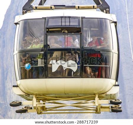 RIO DE JANEIRO-  BRAZIL - JAN 30, 2015: people in Overhead cable car over Sugarloaf Mountain, Rio De Janeiro, Brazil. - stock photo