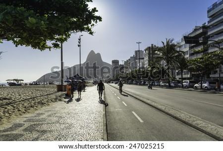 RIO DE JANEIRO, BRAZIL - JANUARY 2015: People relaxing on Ipanema Beach during hot summer day. Ipanema Beach is one of the most popular and crowded in Rio de Janeiro. - stock photo