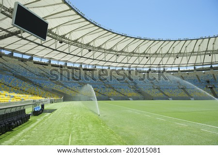 RIO DE JANEIRO, BRAZIL - JANUARY 29, 2014: Pitch-level view of Maracana football soccer stadium, a venue for the Rio 2016 Olympic Games, with sprinklers.