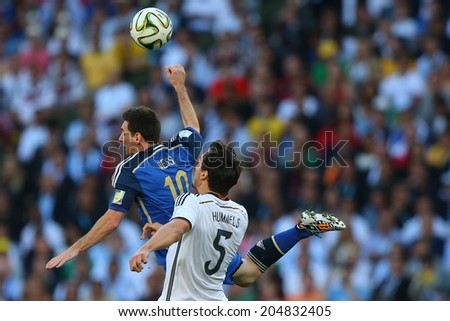 RIO DE JANEIRO, BRAZIL - July 13, 2014: Messi of Argentina and Hummels of Germany during the 2014 World Cup Final game between Argentina and Germany at Maracana Stadium. NO USE IN BRAZIL.