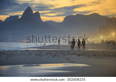 RIO DE JANEIRO, BRAZIL - JULY 17: People relaxing on Ipanema Beach during beautiful  sunset on July 17, 2015.