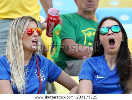 RIO DE JANEIRO, BRAZIL - July 04, 2014: Soccer fans during the World Cup Quarter-finals game between France and Germany at Maracana Stadium. No Use in Brazil.