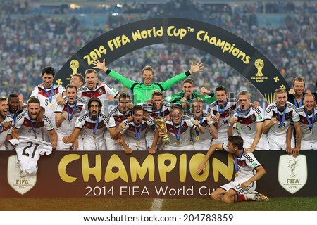 RIO DE JANEIRO, BRAZIL - July 13, 2014: Team Germany posing for a photo with the Trophy after winning the 2014 World Cup Final game between Argentina and Germany at Maracana Stadium. NO USE IN BRAZIL. - stock photo