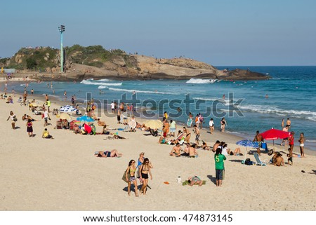 Rio de Janeiro, Brazil - July 7, 2016: Tourists and locals enjoying the sunny day in famous Arpoardor beach