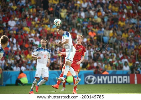 RIO DE JANEIRO, BRAZIL - June 22, 2014: De Bruyne of Belgium and Samedov of Russia competes for the ball during the 2014 World Cup Group H game between Russia and Belgium at Maracana Stadium. No Use in Brazil.