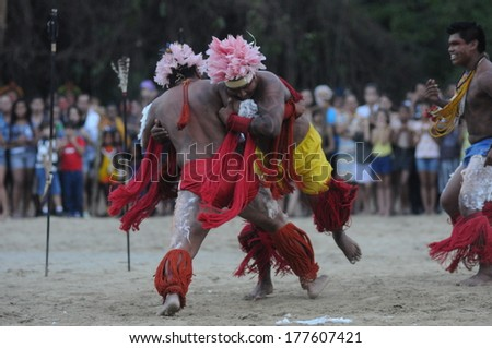 RIO DE JANEIRO, BRAZIL - JUNE 20, 2012: Indigenous tribe from Amazon perform at The United Nations Conference on Sustainable Development, also know as Rio+20. - stock photo