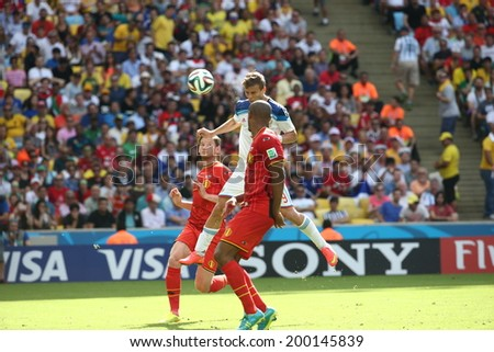 RIO DE JANEIRO, BRAZIL - June 22, 2014: Kokorin of Russia compete for the ball during the 2014 World Cup Group H game between Russia and Belgium at Maracana Stadium. No Use in Brazil.