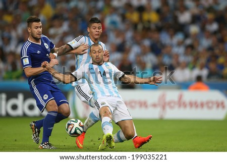 RIO DE JANEIRO, BRAZIL - June 15, 2014: Mascherano of Argentina and Bicakcic of Bosnia compete for the ball during the World Cup Group F game between Argentina and Bosnia at Maracana Stadium. No Use in Brazil.