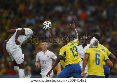 RIO DE JANEIRO, BRAZIL - JUNE 25, 2014: players compete for the ball during the World Cup Group E game between Ecuador and France in the Maracana Stadium. NO USE IN BRAZIL.