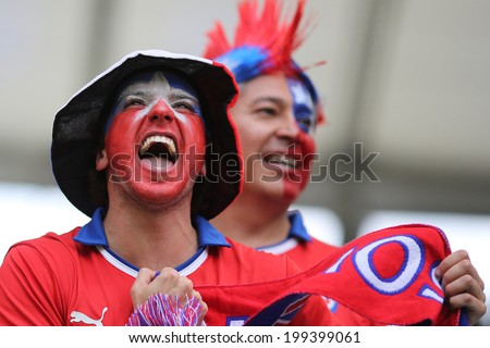 RIO DE JANEIRO, BRAZIL - June 18, 2014: Soccer fans celebrating at the 2014 World Cup Group B game between Spain and Chile at Maracana Stadium. No Use in Brazil. - stock photo