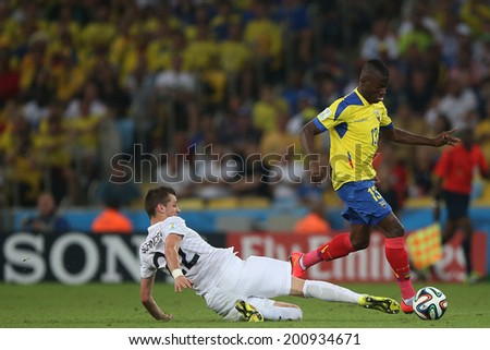 RIO DE JANEIRO, BRAZIL - JUNE 25, 2014: Valencia of Ecuador and Schneiderlin of France during the World Cup Group E game between Ecuador and France in the Maracana Stadium. NO USE IN BRAZIL.