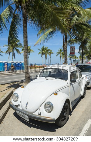 RIO DE JANEIRO, BRAZIL - MARCH 08, 2015: Old white Volkswagen Type 1 Beetle, known locally as a Fusca, parked in front of Ipanema Beach. - stock photo