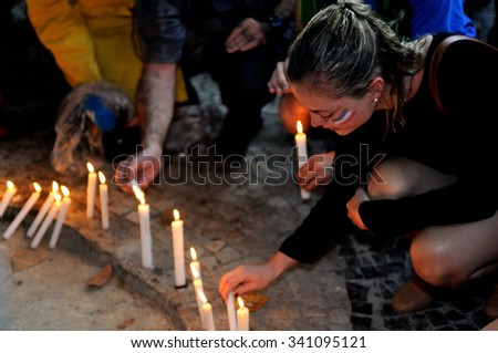 Rio de Janeiro, Brazil - November 15, 2015 - A girl with a French flag painted on her face participates in a vigil in honor of people killed in the Paris attacks. - stock photo