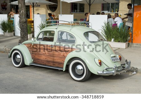 RIO DE JANEIRO, BRAZIL - NOVEMBER 1, 2015: Old Volkswagen Type 1 Beetle, known locally as a Fusca, parked on a street in the surf neighborhood of Itacoatiara, in Niteroi.  - stock photo