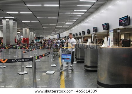RIO DE JANEIRO, BRAZIL - OCTOBER 19, 2014: Travelers check in at Galeao airport of Rio de Janeiro. The airport served 17.1 million passengers in 2013.