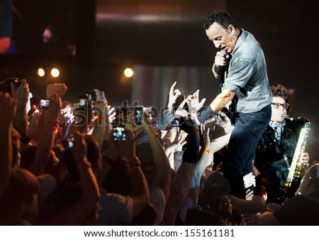 RIO DE JANEIRO, BRAZIL - SEPTEMBER  21:  US singer Bruce Springsteen performs among the audience during the Rock in Rio 2013 concert ,  on September 21, 2013, in Rio de Janeiro, Brazil. - stock photo