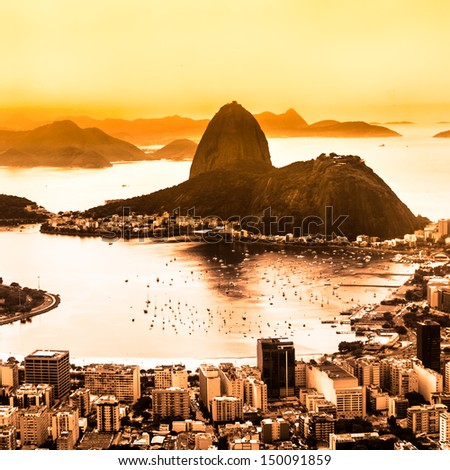 Rio de Janeiro, Brazil. Suggar Loaf and  Botafogo beach viewed from Corcovado at sunset. - stock photo