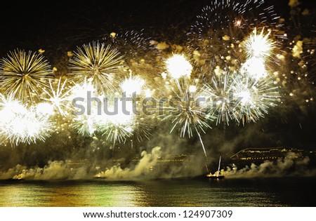 RIO DE JANEIRO - DECEMBER 31, 2012 :  Spectacular fireworks display at Copacabana beach new years eve december 31, 2012 - stock photo