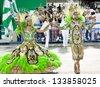 RIO DE JANEIRO - FEBRUARY 10: A woman and men in costume dancing on carnival at Sambodromo in Rio de Janeiro February 10, 2013, Brazil. The Rio Carnival is biggest carnival in world. - stock photo