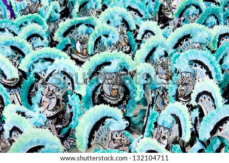 RIO DE JANEIRO - FEBRUARY 11: Dancers in costume at carnival at Sambodromo in Rio de Janeiro February 11, 2013, Brazil. The Rio Carnival is biggest carnival in world. - stock photo