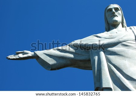RIO DE JANEIRO - JULY 16: Christ the Redeemer, located on top of Corcovado, Rio's highest mountain at approximately 2,330 feet above sea level, is shown July 16, 2013 in Rio de Janeiro, Brazil.  - stock photo