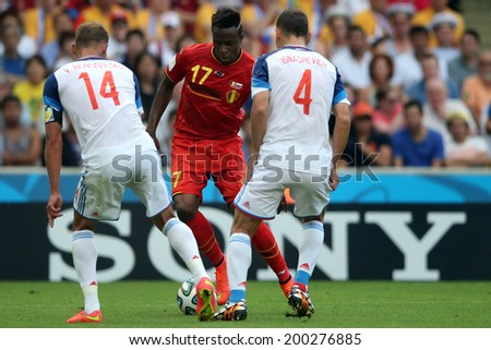 RIO DE JANEIRO - JUNE 22: Berezutskiy, Ignashevich and Origi during the World Cup game between Russia and Belgium at the Maracana stadium on June 22, 2014 in Rio De Janeiro, Brazil. No Use in Brazil.