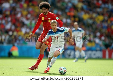 RIO DE JANEIRO - JUNE 22: Shatov and Fellaini during the FIFA World Cup 2014 game between Russia and Belgium at the Maracana stadium on June 22, 2014 in Rio De Janeiro, Brazil. No Use in Brazil.