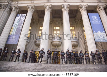 Rio de Janeiro  June 29th, 2016  Anti- riot police agents surrounds Rio' Lower Camera during a  teachers protest for salaries. - stock photo
