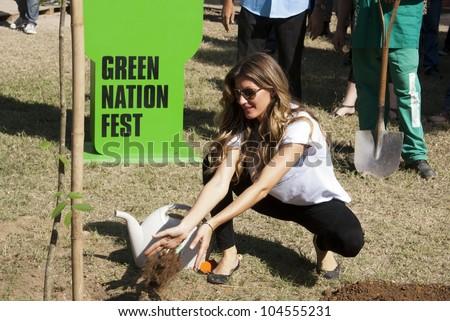 RIO DE JANEIRO - JUNE 04:  Top Model Gisele Bundchen planting the tree Sapucaia. Event Green Nation Fest,June 04, 2012 in Rio de Janeiro,Brazil - stock photo