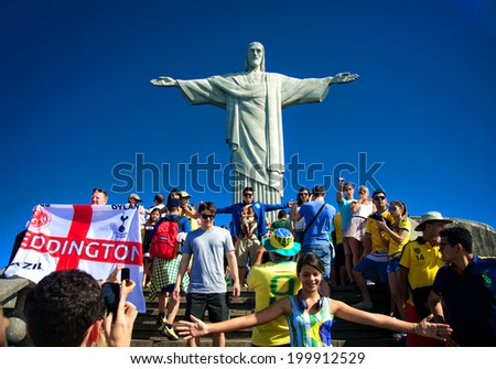 RIO DE JANEIRO, JUNE 12: Tourists on the Corcovado Hill visiting the Christ Redeemer with their national team jerseys the day the FIFA World Cup began  - June 12, 2014 in Rio de Janeiro, Brazil  - stock photo