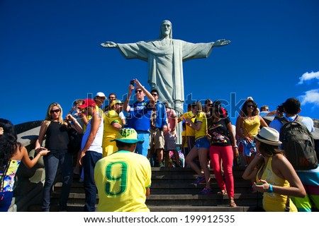 RIO DE JANEIRO, JUNE 12: Tourists on the Corcovado Hill visiting the Christ Redeemer with their national team jerseys the day the 2014 FIFA World Cup began  - June 12, 2014 in Rio de Janeiro, Brazil  - stock photo