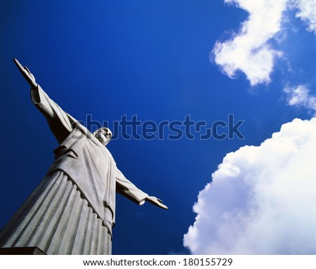 RIO DE JANEIRO - MARCH 15,1996: The 30 m tall statue of 'Christ the Redeemer' in Corcovado Mountain was constructed in 1922-31 as a symbol of Brazilian Christianity.  Statue become an icon for Brazil. - stock photo