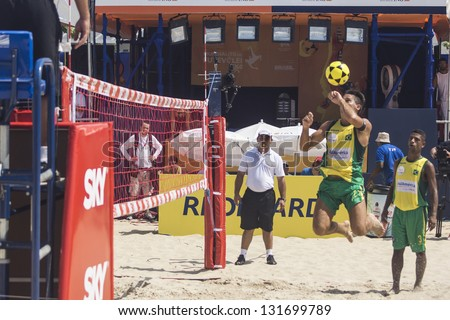 RIO DE JANEIRO - MARCH 09: The team's player of Brazil A, Renato Gaucho, heads the ball to opponent side. Event Mundial de Futevolei 4 X 4 2013,  March 09, 2013 in Rio de Janeiro, Brazil