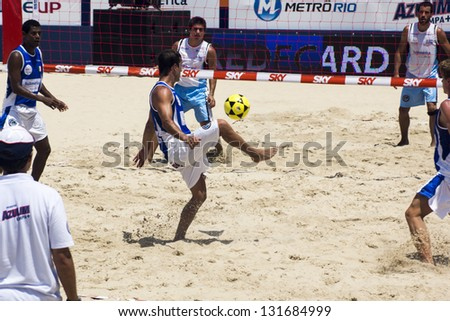 RIO DE JANEIRO - MARCH 09: Unidentified player of Team of Italy kicks the ball.  Event Mundial de Futevolei 4 X 4 2013,  March 09, 2013 in Rio de Janeiro, Brazil