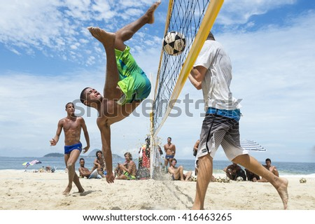 RIO DE JANEIRO - MARCH 17, 2016: Young Brazilian man performs a bicicleta (bicycle kick) in a game of futevôlei (footvolley, a sport that combines football and volleyball) on Ipanema Beach.  - stock photo
