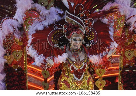 RIO DE JANEIRO, RJ /BRAZIL - MARCH 08, 2011: Samba School parade in Sambodromo. Beija Flor School, one of the most famous during festival on march 08, 2011 in Rio de Janeiro. - stock photo