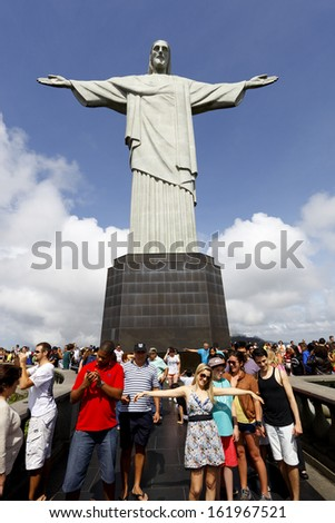"RIO DE JANEIRO - 2013: Tourists visit Christ the Redeemer, Corcovado, meaning ""hunchback"" in Portuguese, is a mountain in central Rio de Janeiro, Brazil.  - stock photo"