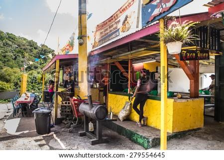 RIO GRANDE, PUERTO RICO - MARCH 28:  Outdoor roadside food stand in El Yunque Rainforest in Puerto Rico - stock photo