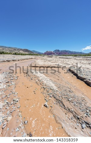 Rio Grande river on the colourful valley of Quebrada de Humahuaca in Jujuy Province, northern Argentina.