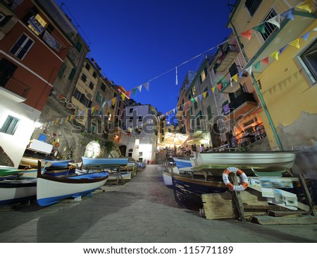 Riomaggiore at dusk in Cinque Terre, Italy - stock photo
