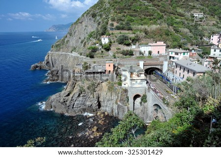 Riomaggiore is one of five famous colorful villages of Cinque Terre in Italy - stock photo